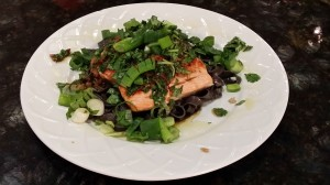 Salmon with squid ink pasta